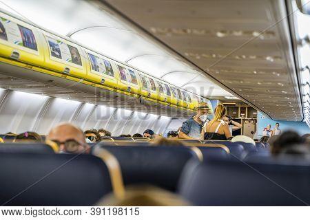 Malaga / Spain - August 15th, 2020 Passengers Boarding Plane, Wearing Face Masks, Ryanair