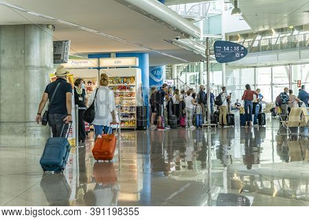 Porto / Portugal - August 18th, 2020: Passengers Waiting Inside Airport Waiting In Line For Boarding