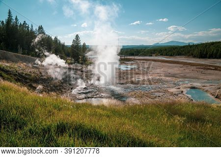 Daytime Sunshine View Of Ledge Geyser In The Norris Geyser Basin In Yellowstone National Park