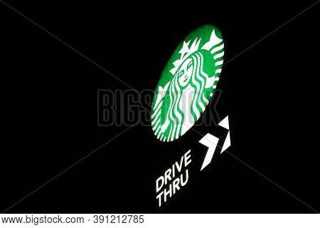 Nakhon Pathom, Thailand - Sep 17, 2017: The Light Box Of Starbucks Coffee Logo Drive Thru At Night.