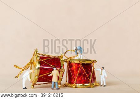 Miniature People,  Worker Team Painting A Christmas Decoration