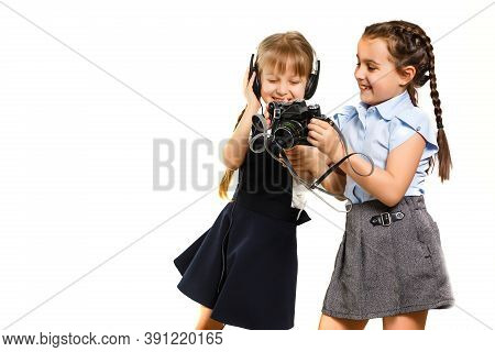Two Little Schoolgirls At Recess. Children Enjoy This Recess. They Smile Fun.