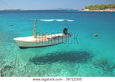 Boat in a quiet bay of Milna on Brac island, Croatia