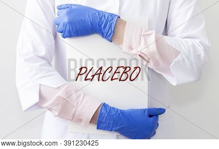 Placebo Word, Concept Inscription. Female Doctor Hands With Paper Close Up.