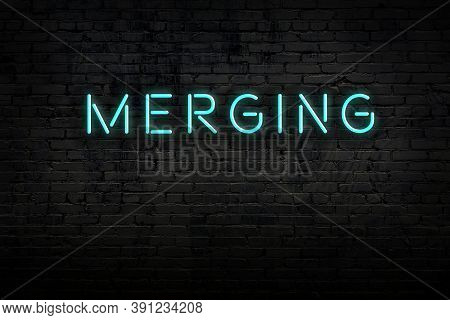 Neon Sign On Brick Wall At Night. Inscription Merging