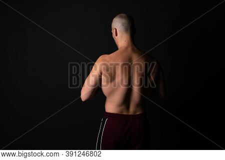 A Sports Man Of Beautiful Strength In Training Pumps Up Muscles. Strong Bodybuilder, Powerful Abs, S
