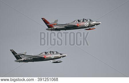 Helsinki, Finland - 9 June 2017: Two Silver Jets Aerobatic Team Fouga Cm 170 Magister Jets Flying At