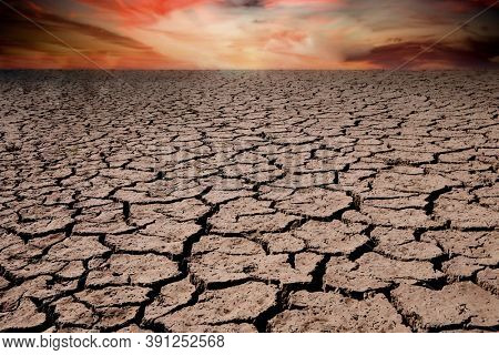 Brown dry soil or cracked ground texture background