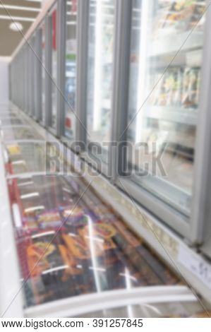 Glass Showcase With Chilled Semi-finished Products In A Large Light Supermarket. Blurred. Vertical.