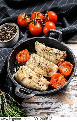 Fried Cod Fish Fillet With In A Cast Iron Pan. White Background. Top View.
