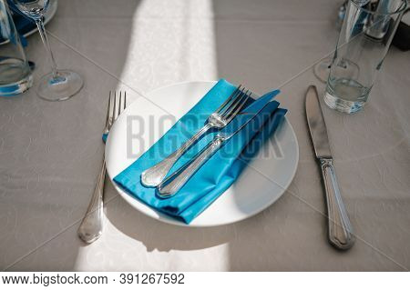 Serving, Setting Table. Plate And Silverware Cutlery Linen Blue Napkin. Wedding Table Decoration. Ar