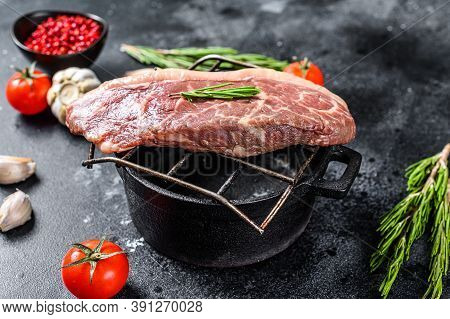 Raw Picanha Or Top Sirloin Cap Steak On A Grill. Black Background. Top View
