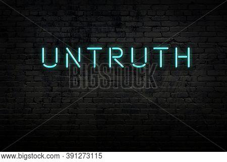 Neon Sign On Brick Wall At Night. Inscription Untruth