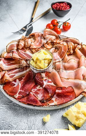 Set Of Cold Cured Italian Meat Ham, Prosciutto, Pancetta, Bacon. White Background. Top View