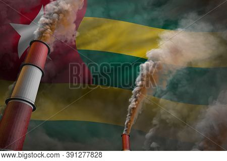 Pollution Fight In Togo Concept - Industrial 3d Illustration Of Two Large Plant Chimneys With Dense