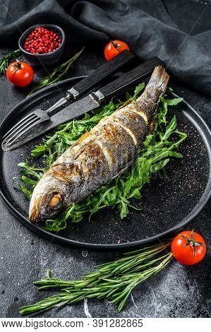 Bbq Sea Bass Fish With Arugula, Fried Sea Bass. Black Background. Top View