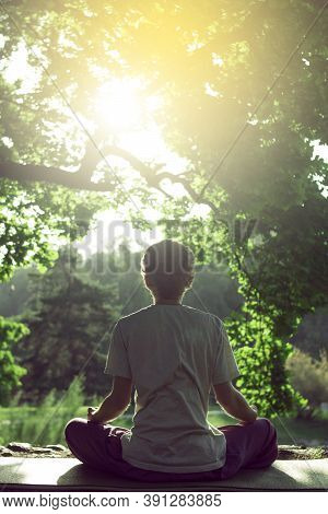 A Man In A White T-shirt With Red Hair Is Meditating On The Nature