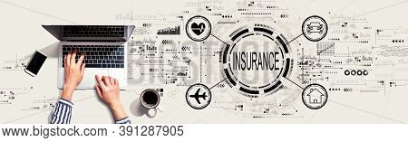 Insurance Concept With Person Using A Laptop Computer
