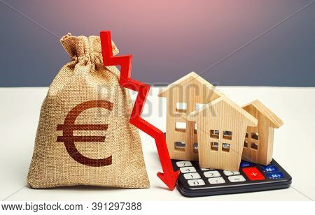 Euro Money Bag With Down Arrow And Houses On Calculator. Saving Resources And Reducing Maintaining C
