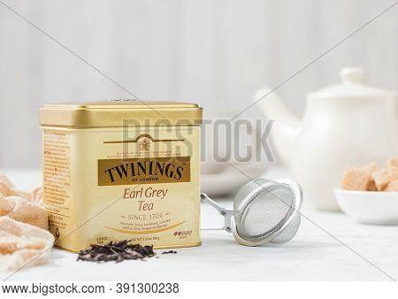 London, Uk - October 21, 2020: Steel Jar Of Twinings Earl Grey Loose Tea With Iron Teapot And Strain