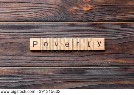 Poverty Word Written On Wood Block. Poverty Text On Cement Table For Your Desing, Concept