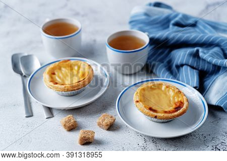 Portuguese Custard Pies, Pastel De Nata Or Pastel De Belem. Traditional Portuguese Pastry