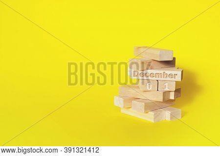 December 1st . Day 1 Of Month, Calendar Date. Wooden Blocks Folded Into The Tower With Month And Day