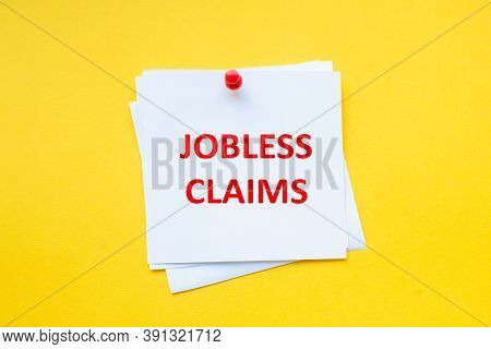 Jobless Claims. Word On White Sticker With Yellow Background
