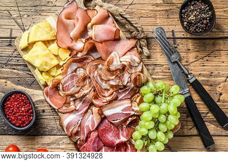 Meat Antipasto Board, Pancetta, Salami, Sliced Ham, Sausage, Prosciutto, Bacon With Grape And Parmes
