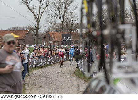 Templeuve-en-pévèle, France - April 08, 2018: Rear View Of A Group Of Cyclists Riding During Paris-r