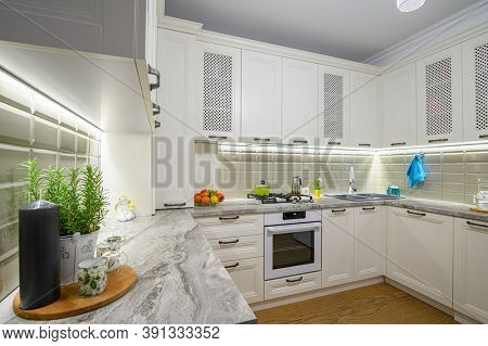 White cozy and comfy contemporary classic kitchen interior with wooden furniture