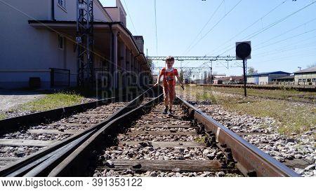 Sremska Mitrovica, Serbia, June 1, 2020. Boy With A Protective Mask Runs On The Railroad. Railroad T
