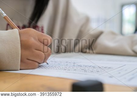 Student Taking Notes Lecture In High School Or University With Holding Pencil Writing On Paperwork S