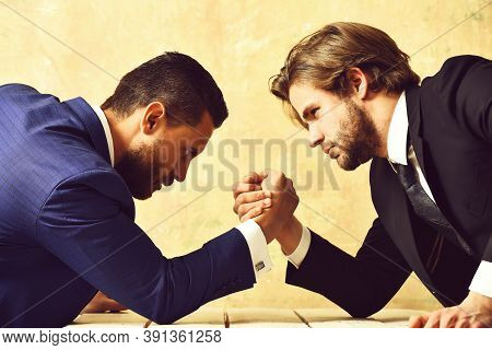 Business, Partners, Crisis And Confrontation Concept Businessmen Arm Wrestling In Office.