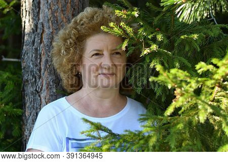 Portrait Of A Woman Posing In The Forest, Summer, Green Fir Branches, Outdoor Activities