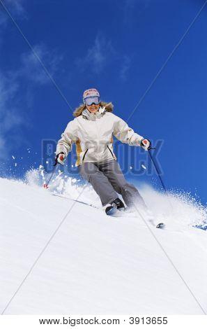 Woman Skiing Down Mountain