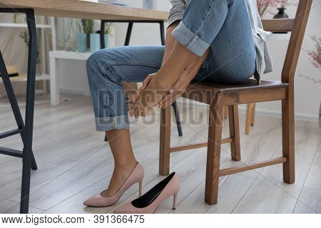 Close Up Of Woman Massage Feet Suffering From Uncomfortable Shoes