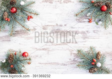 Christmas Frame With Traditional Red And Silver Christmas Decorations, Fir Cones And Sprigs Of Blue