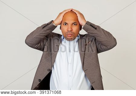 Upset Shocked Young African American Guy Businessman, Holding Hands On His Head, Was Shocked By Frow
