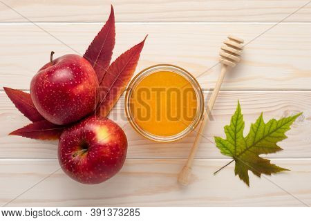 Honey In A Glass Jar And Red Apples On A White Wooden Background. Celebration Rosh Hashanah, Full Ye