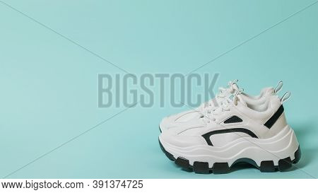 The Ultra-modern Sneakers On A High Sole On A Blue Background. Sports Shoes With High Soles. Place F