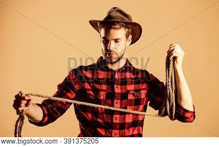 Lasso Master. Man Checkered Shirt On Ranch. Western Cowboy Portrait. Cowboy With Lasso Rope. Western