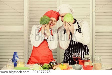 Organic Food. Man And Woman Chef. Happy Couple In Love With Healthy Food. Family Cooking In Kitchen.