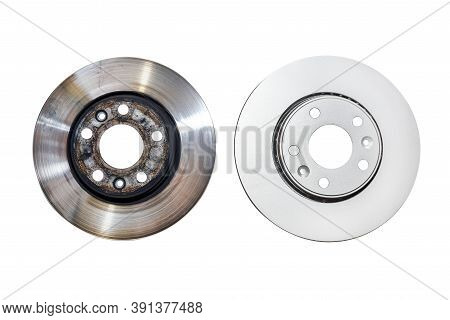 New Brake Disc With Anti-corrosion Treatment And Old Brake Disc, Isolated On A White Background With