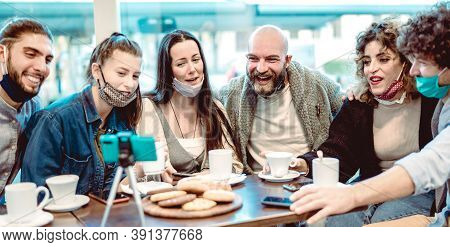 Young Happy Friends Sharing Content On Streaming Platform Wearing Face Mask - New Normal Lifestyle C