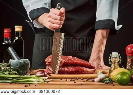 Chef Is Ready To Cook A Beef Steak With His Sharp Santoku Knife