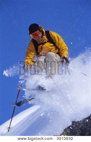 Man Skiing Off Mountain