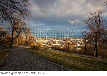 View From Petrin Park On Prague City At  Sunset, Czech Republic. Aerial Panoramic View Of The Histri