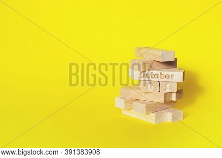 October 1st . Day 1 Of Month, Calendar Date. Wooden Blocks Folded Into The Tower With Month And Day