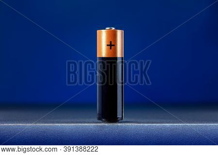 Electrical Energy And Power Supply Source Concept, Accumulator Battery On Blue Background. Concept U